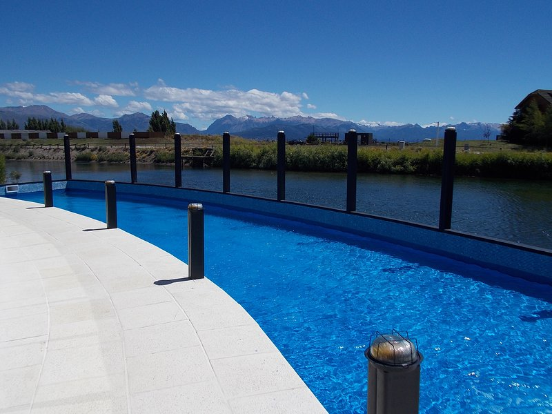 Pool, lake and mountains