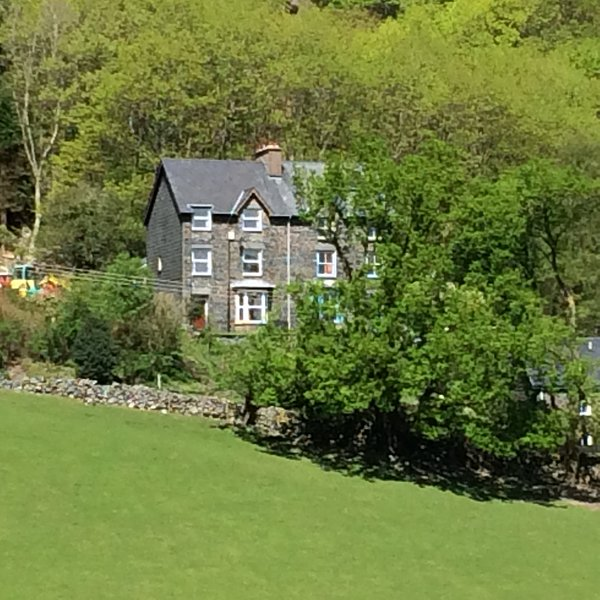 Located on a quiet lane Isygraig has south facing views across the valley and over the old village .