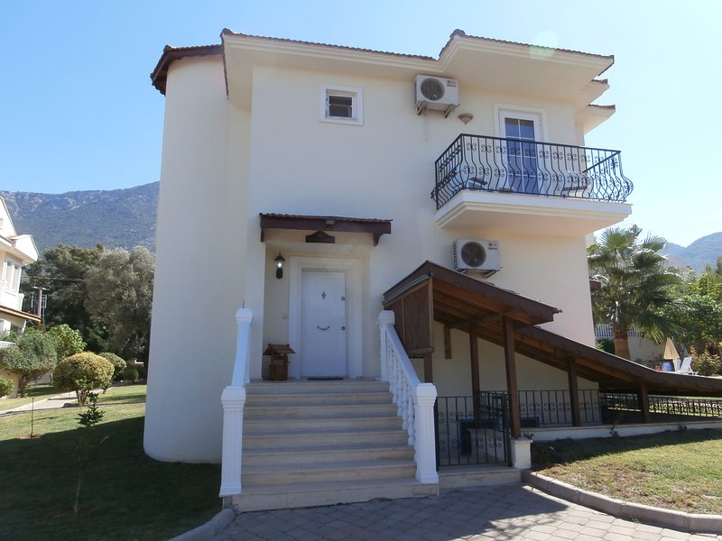 Front entrance of villa with mountains in the background