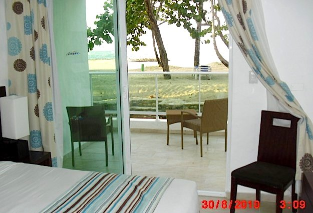 Beach and terrace view from inside.