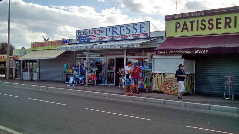 Shops down the street going to the beach less than 300m