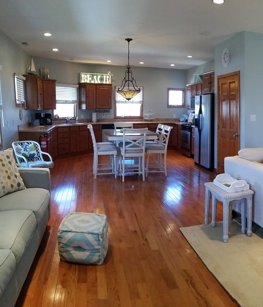 Well appointed kitchen with stainless appliances. Seating for 6. Refrigerator, dishwasher& more