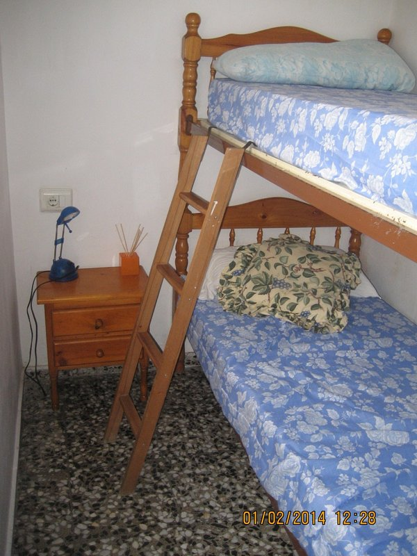 Bedroom with a bunk bed. On the sofa you can also sleep a person. Up to 5 people.
