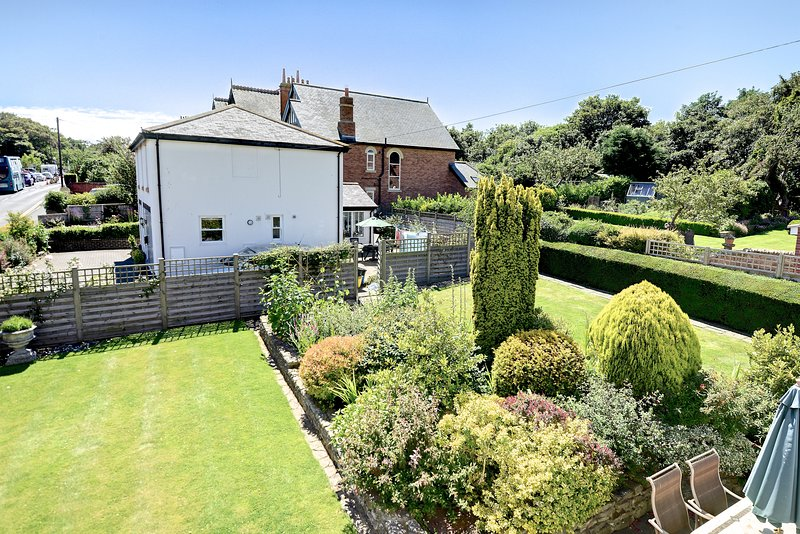 View from first-floor twin bedroom of beautiful enclosed gardens. Great for children to explore