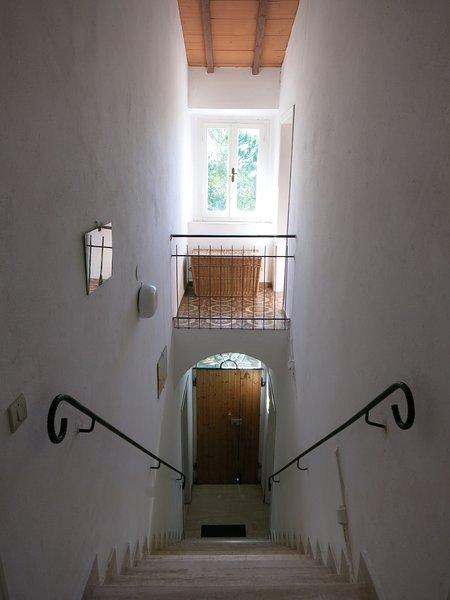 staircase towards front door