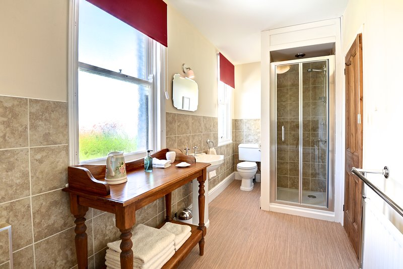 Large ensuite to master bedroom, with separate bath and shower enclosure
