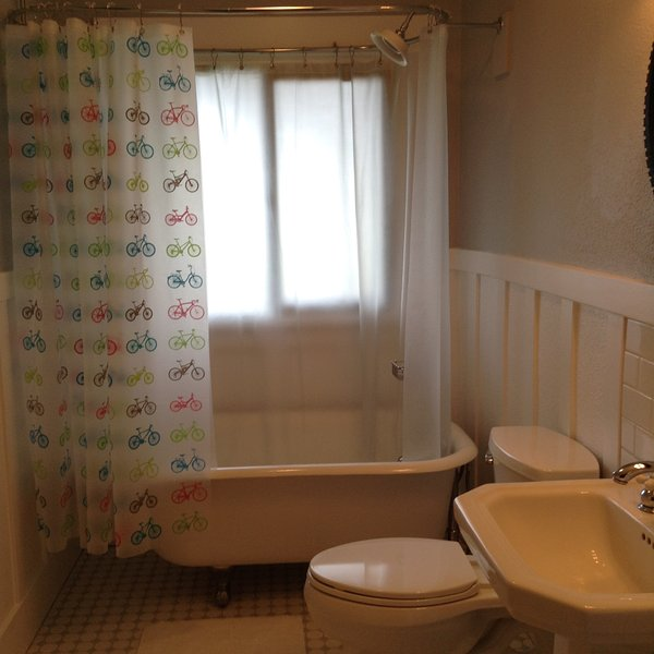 It features the original clawfoot tub