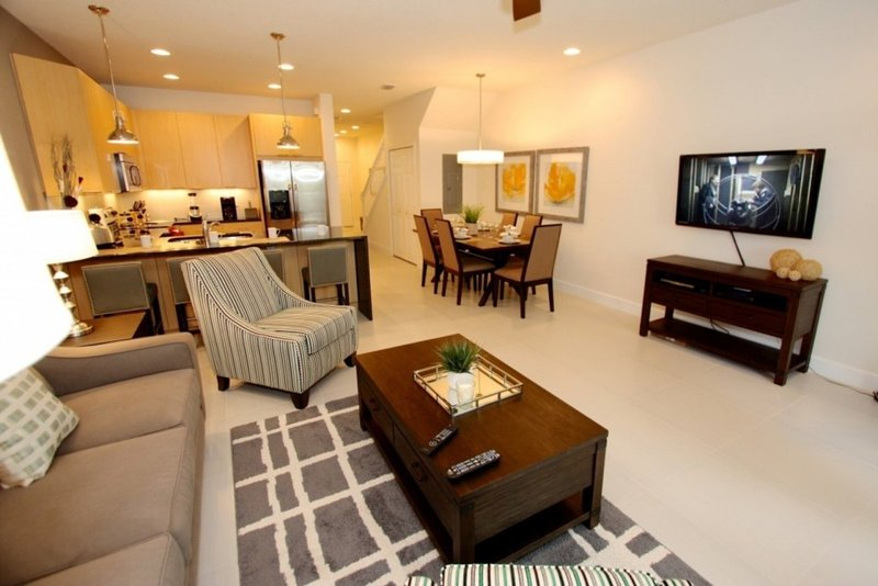 Open plan living room, dining room and kitchen.