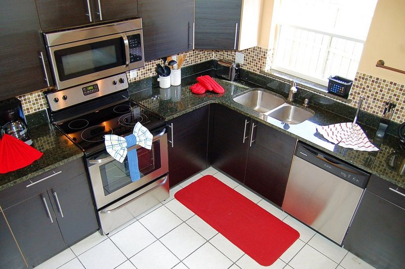Kitchen with stainless steel appliances and granite countertop