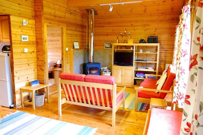 Ouvrir le plan coin salon avec poêle à bois.
