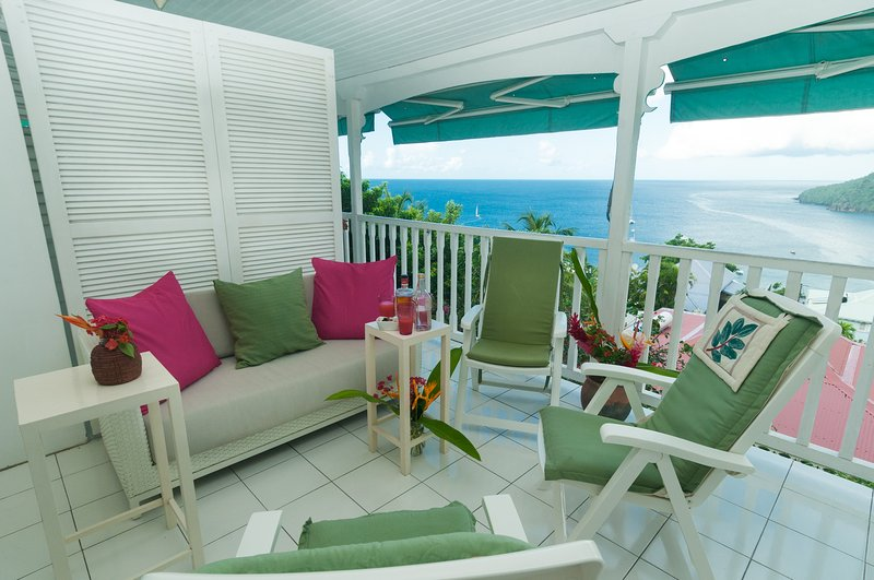 the lounge on the terrace detail: sofa, armchairs, cushions. VIEW exceptional sea.