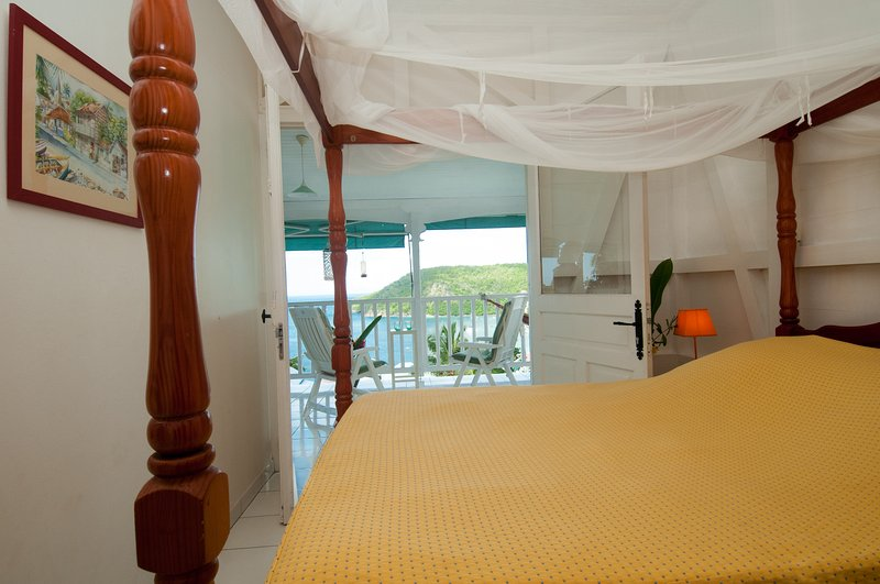 bedroom with double bed sea view.
