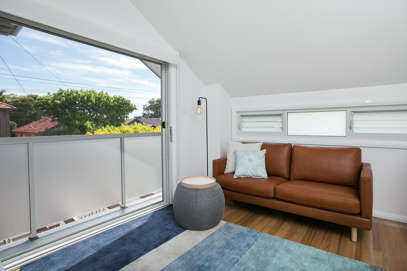 Comfy leather lounge and petite balcony