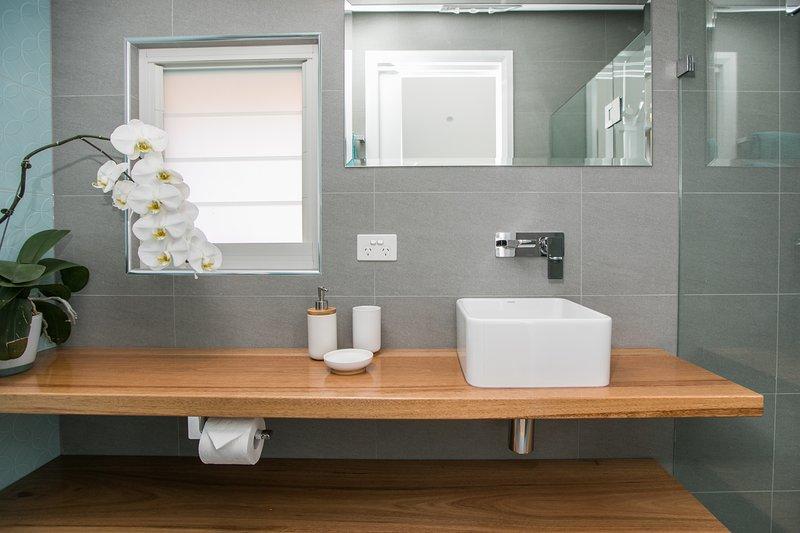Bathroom has heated tile floors &radiant heat.  Good lighting & power for ease of getting ready