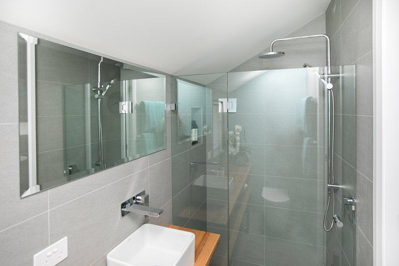Glass shower enclosure and dual rose shower head.  Towels & toiletries supplied