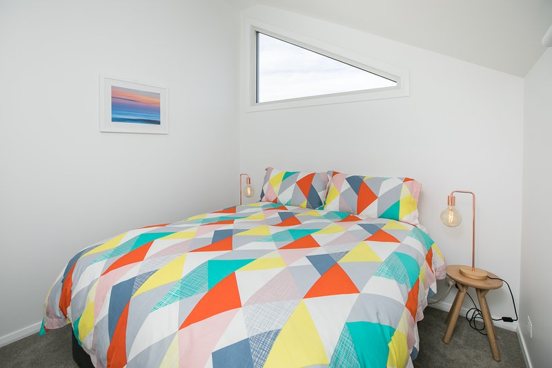 Bedroom with queen size bed, all linens supplied.