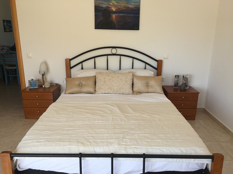 Large bedroom. with window and patio doors to front balcony