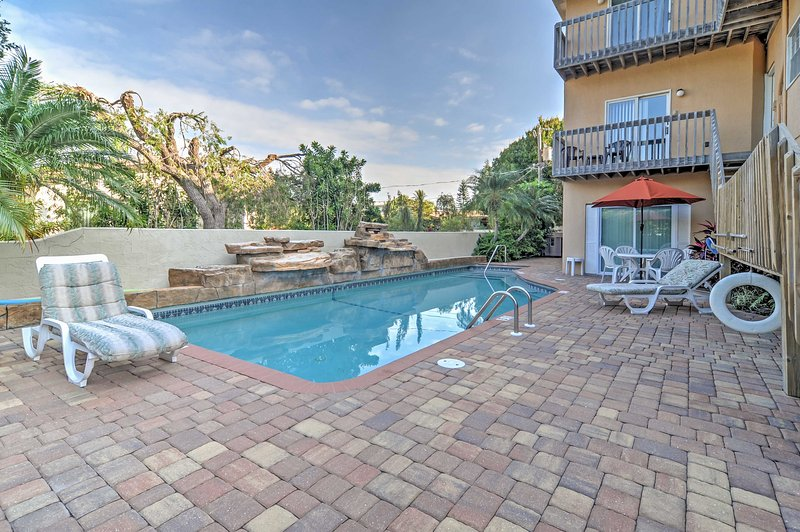 Enjoy the pool which boasts a 30' wide rock waterfall & tropical landscaping.