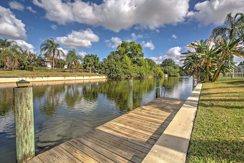 The home is located on a freshwater canal, offering easy access to fishing, kayaking, or sun bathing.
