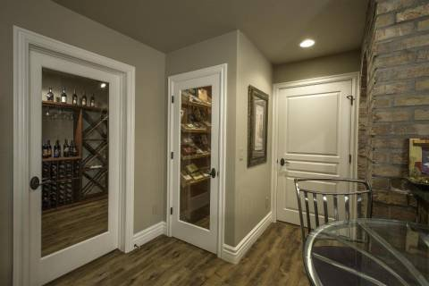 Man cave with wine cellar, humidor and kegerator.
