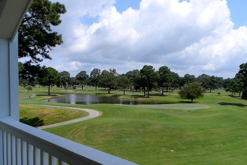 View from private balcony overlooking golf course and lake.