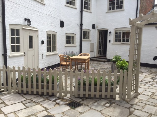 Sunny courtyard, shared with Little Green. Both cottages have their own table and chairs. Sun trap!