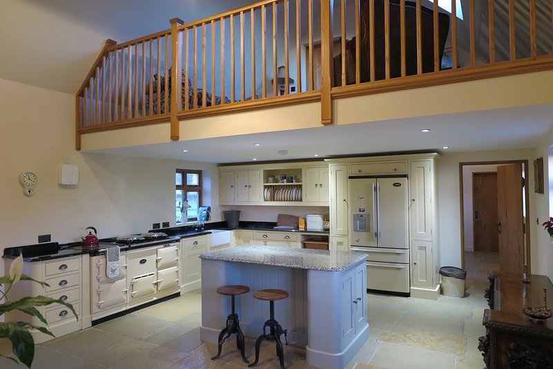 The large farm house kitchen with aga and flagstone floor.