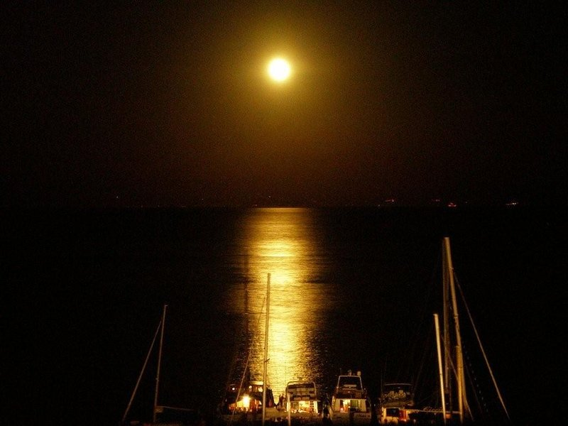 Reflections of the moon on a beautiful bay of Lipari, seen from the apartment.