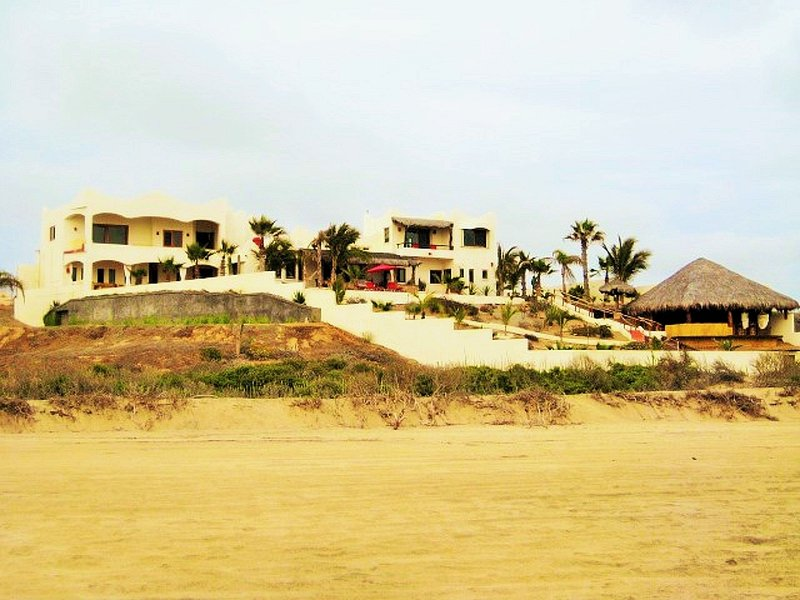 6500 sq ft Villa perched up on a gentle bluff with miles of ocean and sandy white beach views