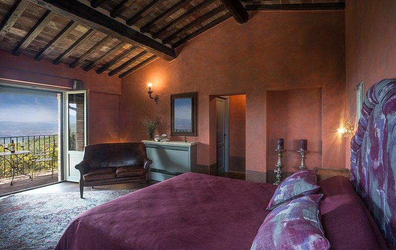 One of Villa Mandorlo's double bedrooms with ensuite bathroom and terrace