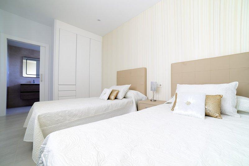 2 º dormitorio principal con Habitación con baño