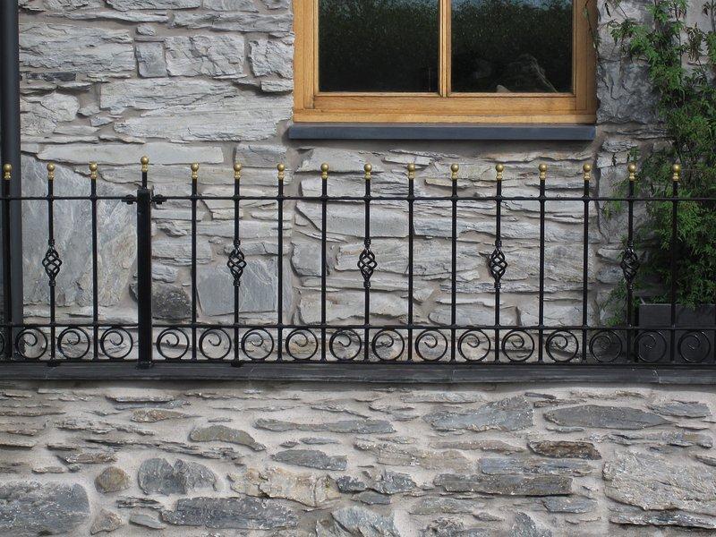 Handmade iron railings outside.
