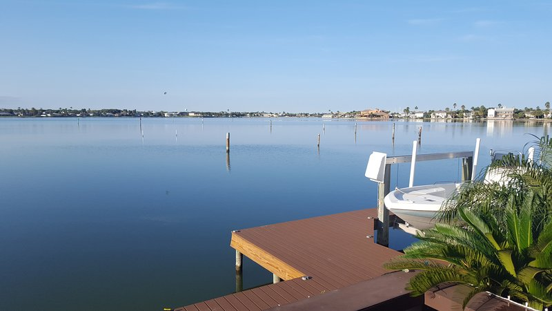 New, 150 foot dock offers ample space for lounging, fishing and sunset watching