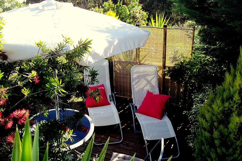 Private poolside terrace with sun-beds and dining table