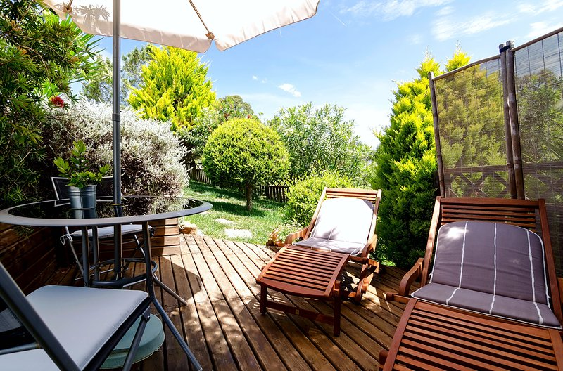 Private poolside terrace with sun loungers and dining table