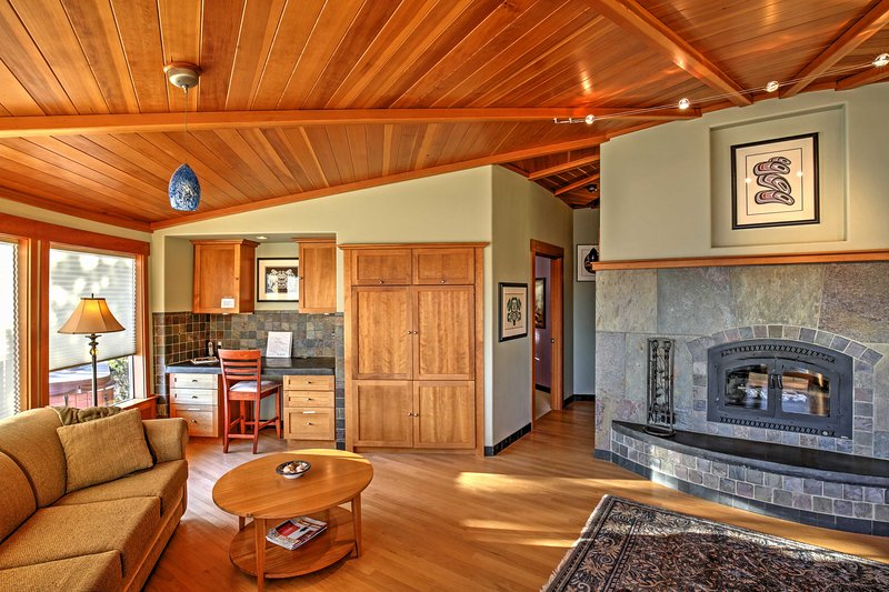 Gather with your guests in the inviting living room and enjoy the warmth of the wood-burning fireplace while playing a board game.