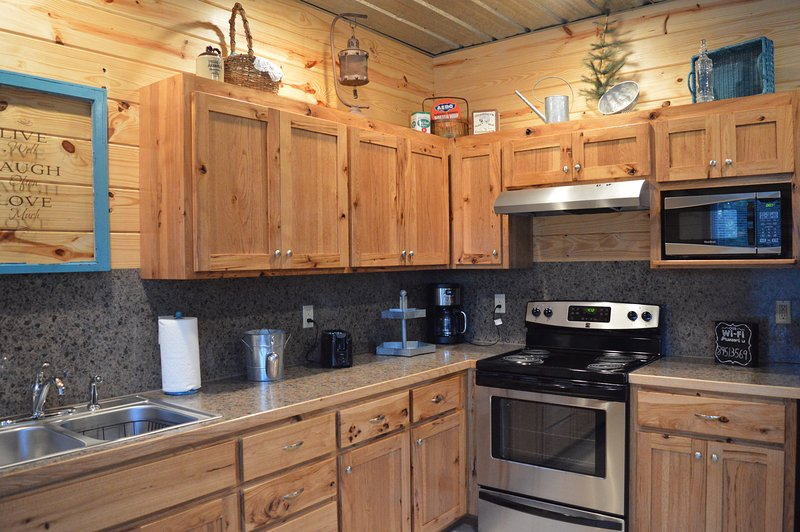 Kitchen with full sized appliances.