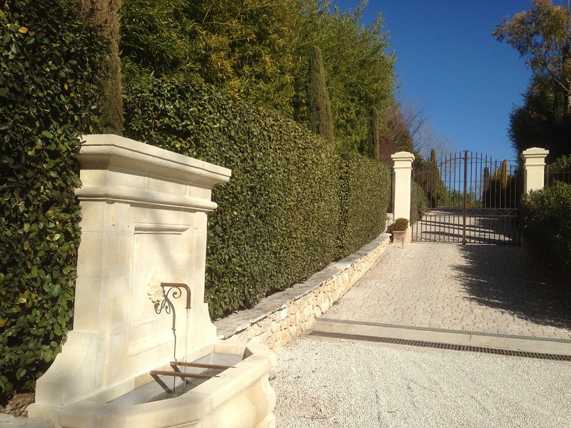 Main entrance of the property with its beautiful fountain where the water of the mountains flows .