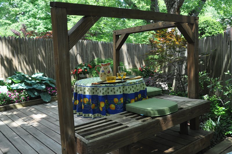 Beautiful, fenced in back deck perfect for outdoor dining or relaxing after a day of sightseeing.
