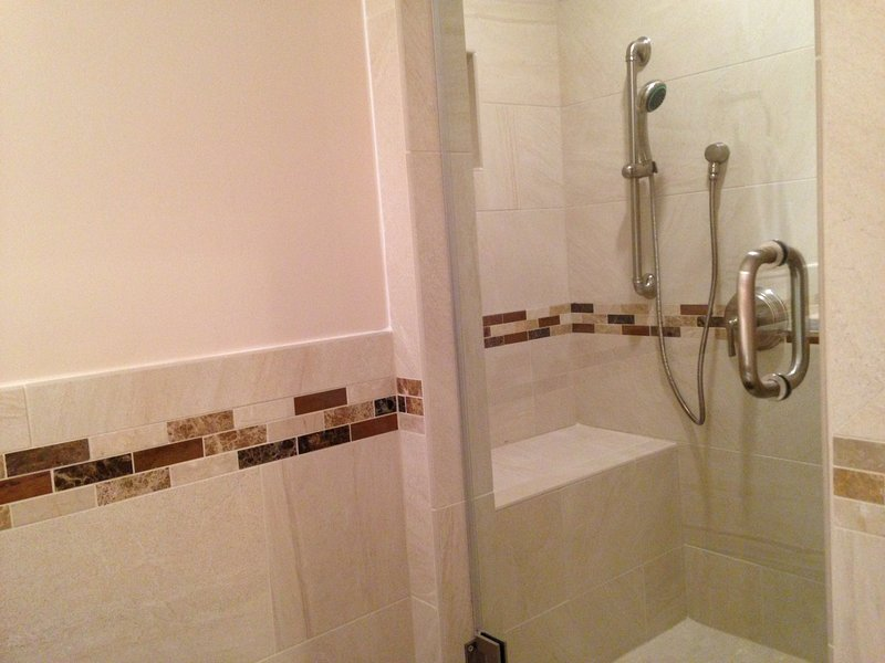 Fully remodeled full bath off basement family room/extra bedroom, with walk-in shower.