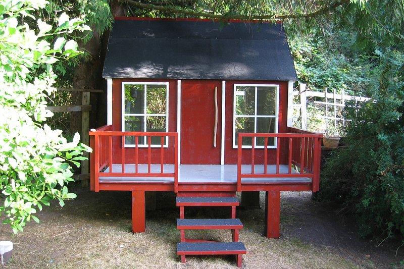 Kids playhouse in back yard