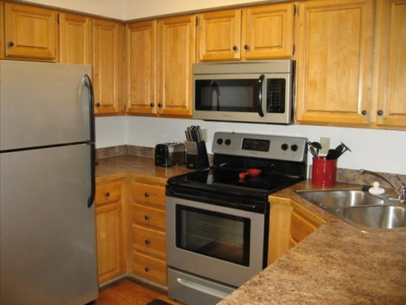 Fully stocked kitchen with full size stainless steel appliances