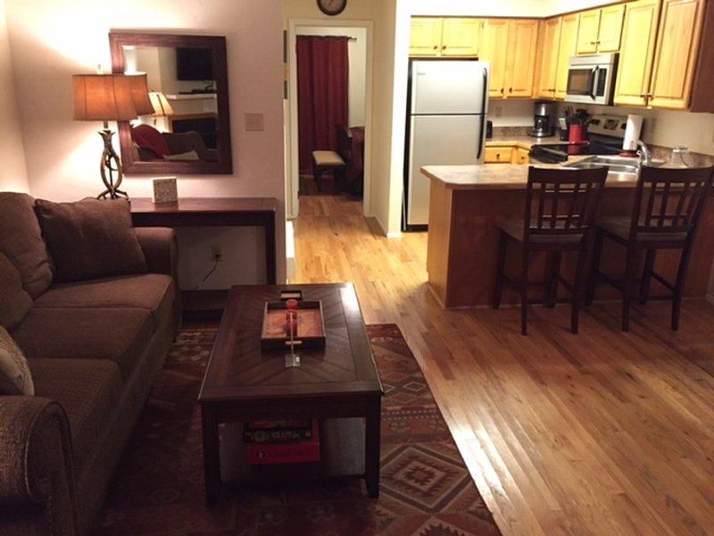 Distinctive Condo with modern decor, comfy furnishings, and hardwood floors.