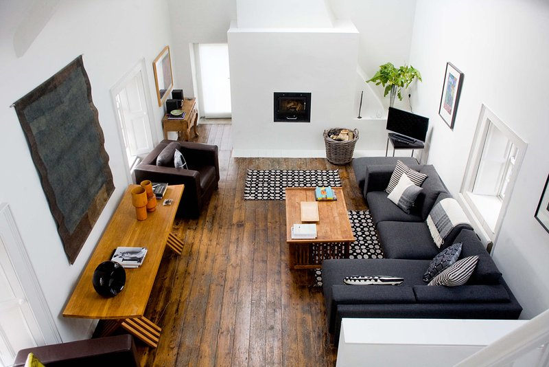 DOUBLE HEIGHT LIVING ROOM AT BALLILOGUE HOUSE