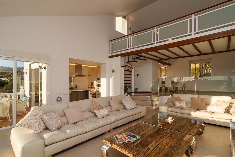 Spacious lounge leading to terraces..