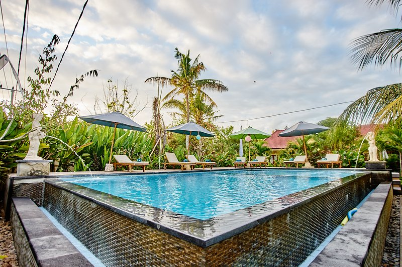 sorrounding tropical garden view with exclusive Ac room, vacation rental in Ped