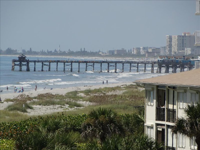 WALK along the beach to the COCOA BEACH PIER! You are Just NORTH of the Pier, this picture taken from your PRIVATE Balcony!!