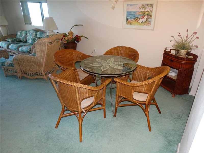 A DEEPER View of the DINING ROOM area.  Centrally located and wicker!