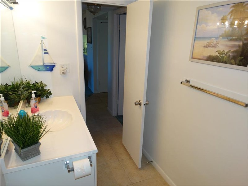 It doesnt really get much better than Canaveral Beach 402!  Here is the view out into the unit from the HALL Bath!