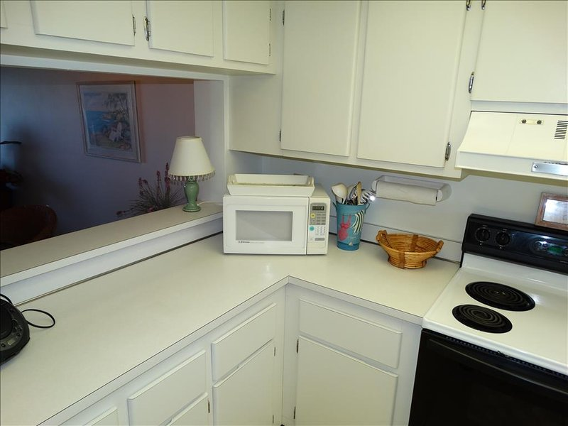 The Kitchen is among our FAVORITE at Cocoa Beach!  Beautiful WHITE Cabinets!
